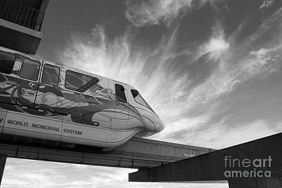 Photograph - Backlit Disney World Monorail Leaving Contemporary Resort Walt Disney World Prints Black And White by Shawn O'Brien