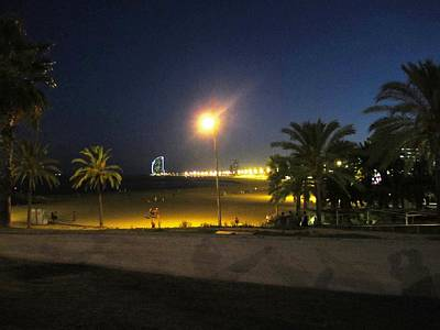 Photograph - Barcelona Beach Pier By Night Light Pole In Spain by John Shiron