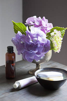 Bowl Of Flowers Photograph - Bathing Products And Hydrangeas On Table by Susan Findlay