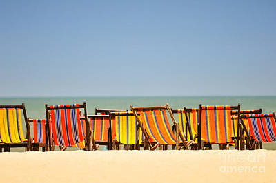 Beach Chairs Colorful  Art Print by Panupong Roopyai