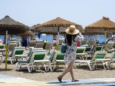Photograph - Beach Girl With Sun Protection Hat Spain by John Shiron