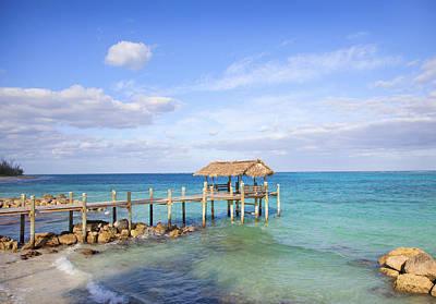 Bahamas Pier Photograph - Beach Pier Near Sea by Grant Faint