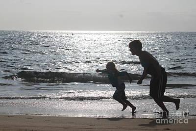 Photograph - Beach Play At Dusk by Terri Thompson