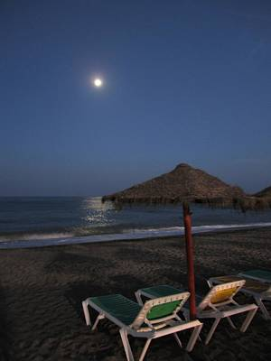 Moon Rise Poster Photograph - Beach Umbrella Under The Moon Costa Del Sol Spain by John Shiron