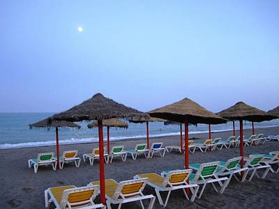 Moon Rise Poster Photograph - Beach Umbrellas And Chairs Moon Lit Costa Del Sol Spain by John Shiron