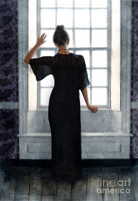 Beatiful Young Woman In A Black Gown Standing By The Window Art Print