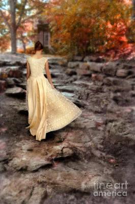 Beautiful Young Lady In Gown Walking Up Stone Walkway Art Print by Jill Battaglia