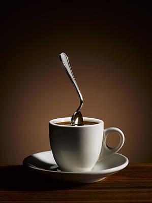 Stiff Photograph - Bent Spoon Stuck In Strong Coffee by Sabine Scheckel