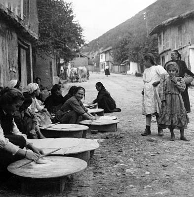 Bread Making Photograph - Berkovitsa Bulgaria - Women Making Bread In The Streets - C 1911 by International  Images