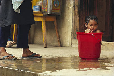Bhutanese Boy Bathing In A Bucket Art Print by James L. Stanfield