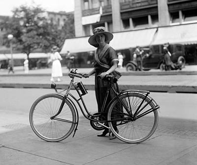 Bicycle. Times Girl On Bicycle, 1921 Art Print by Everett