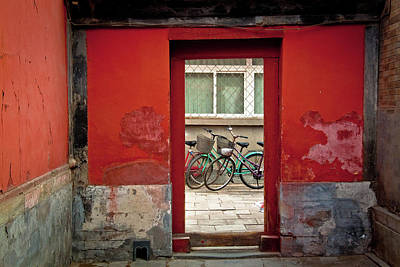 Bicycles In Red Doorway Art Print by photo by Sharon Drummond
