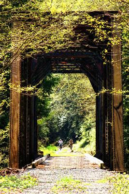 Bicycling Across Old Train Bridge Art Print