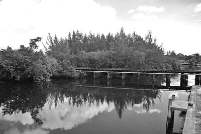 Photograph - Big Sky And Docks On The River In Black And White by Rob Hans