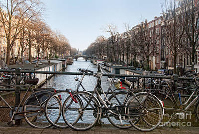 Art Print featuring the digital art Bikes On The Canal In Amsterdam by Carol Ailles