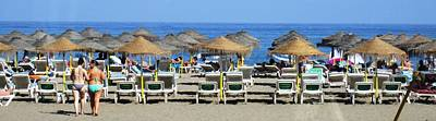 Photograph - Bikini Girls Beach Umbrellas Costa Del Sol Spain by John Shiron