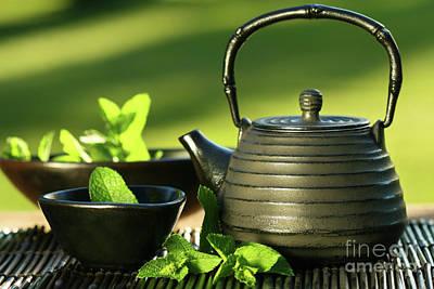 Black Asian Teapot With Mint Tea Art Print by Sandra Cunningham