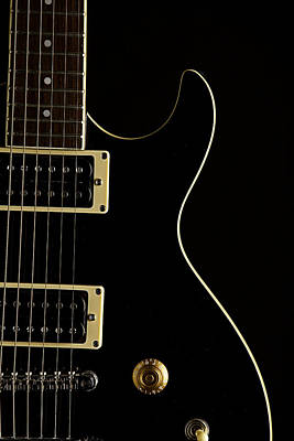Photograph - Black Electric Guitar On Dark Background by M K Miller