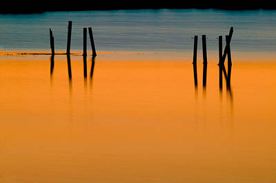 Black Pilings Orange Water Art Print