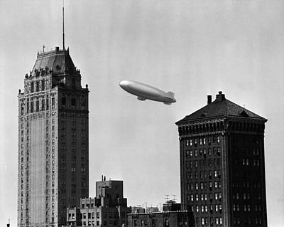 Blimp Over City Art Print by George Marks