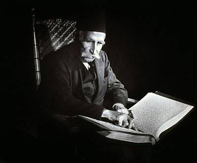 Blind Man Reading A Braille Book, Ca Print by Everett