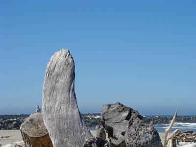 Blue Sky Coastal Landscape Driftwood Rock Pier Art Print by Baslee Troutman
