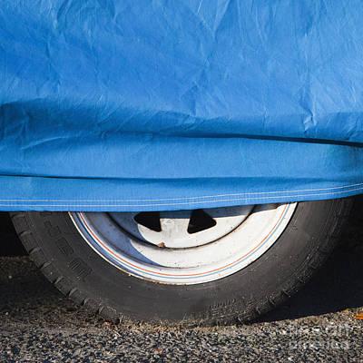 Blue Tarp And Car Wheel Art Print by Paul Edmondson