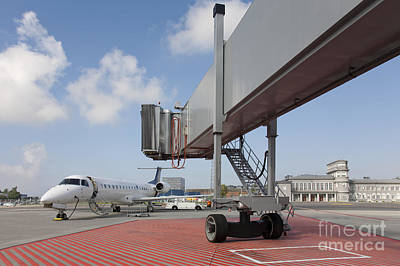 Boarding Bridge Leading To A Parked Plane Art Print by Jaak Nilson