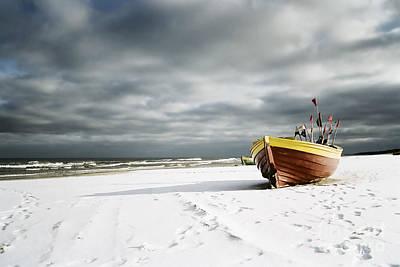 Boat On Snowy Beach Art Print by Agnieszka Kubica