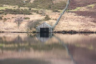 Photograph - Boathouse Reflection by Ed Lukas