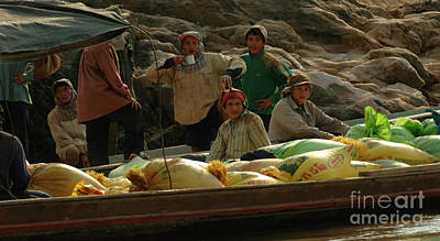 Boat Along The River Photograph - Boatmen In Laos by Bob Christopher