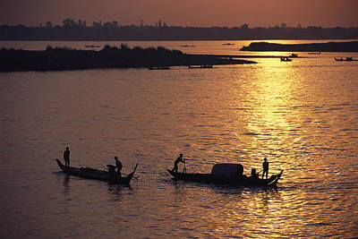 Boats Silhouetted On The Mekong River Art Print by Steve Raymer