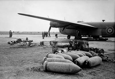 Bombs Lie On An Allied Airfield Ready Art Print by Everett