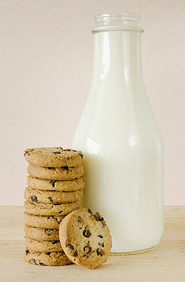 Bottle Of Milk And Chocolate Chip Cookies, Studio Shot Art Print by Tetra Images