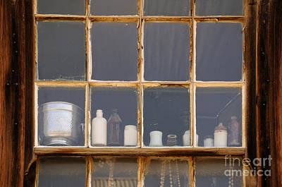 Bottles In The Window Art Print by Vivian Christopher
