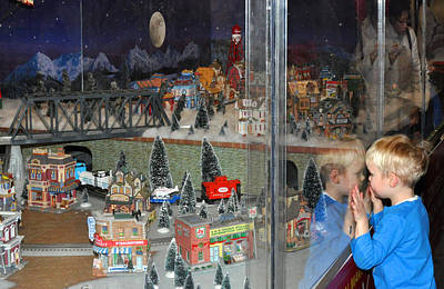 Art Print featuring the photograph Boy And Christmas Trains by Diane Lent