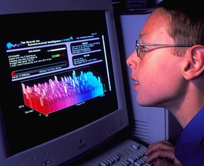 Boy At Computer Displaying Seti@home Screen Saver Art Print by David Parker