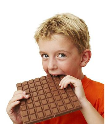 Boy Eating Chocolate Art Print by Ian Boddy