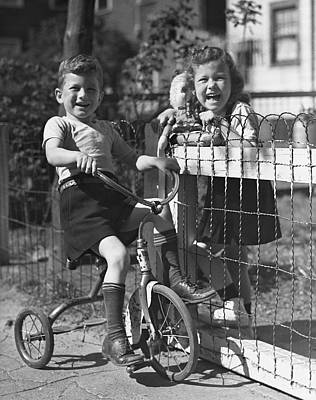Boy On Tricycle W/ Girl Art Print by George Marks