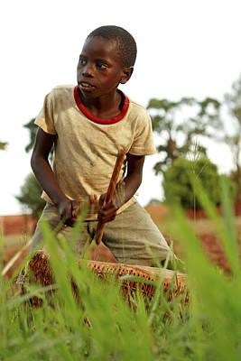 Boy Playing A Drum, Uganda Art Print by Mauro Fermariello