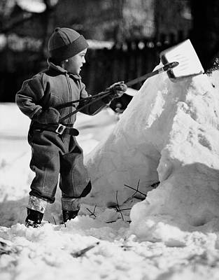 Snow Shovels Photograph - Boy Playing With A Shovel In The Snow by George Marks