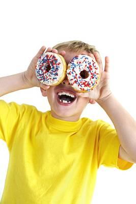 Boy Playing With Doughnuts Art Print by Ian Boddy