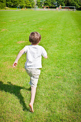 Royalty-Free and Rights-Managed Images - Boy running by Tom Gowanlock