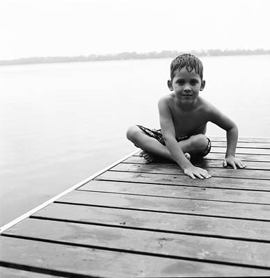 Boy Sitting On Dock Art Print by Michelle Quance