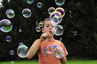 Photograph - Boy With Colorful Bubbles by Matthias Hauser