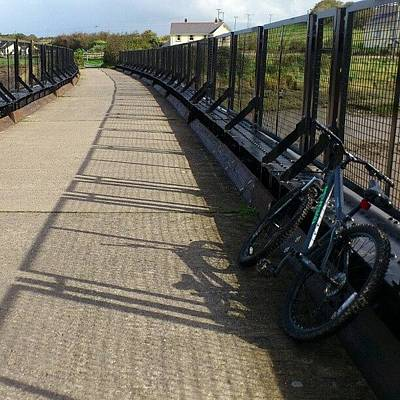 Beer Wall Art - Photograph - #bridge Over #fremington Quay. #cycling by Robin Beer