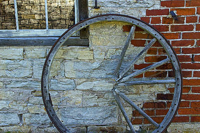 Wagon Wheels Photograph - Broken Wagon Wheel Against The Wall by Randall Nyhof