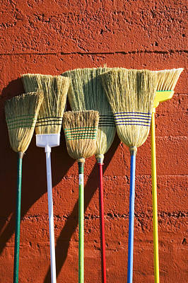 Brooms Leaning Against Wall Print by Garry Gay