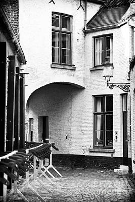Architecture Photograph - Bruges Alley by John Rizzuto