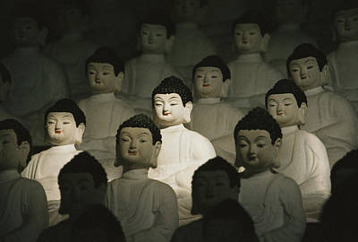 Religious Characters And Scenes Photograph - Buddha Statues In The Cave Temple by Martin Gray